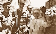 Sister_of_the_St._Louis_Hospital_in_Jerusalem_holding_up_a_denture_recovered_after_having_fallen_out_of_the_window_into_no-man's-land,_22_May_1956