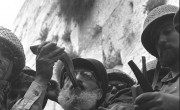 Six_Day_War._Army_chief_chaplain_rabbi_Shlomo_Goren,_who_is_surrounded_by_IDF_soldiers,_blows_the_shofar_in_front_of_the_western_wall_in_Jerusalem._June_1967._D327-043